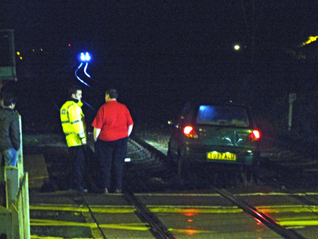 Car on Railway track in Oulton Broad