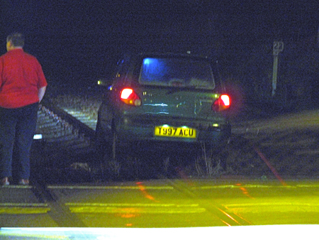 Car on railway track at Outlon Broad Suffolk